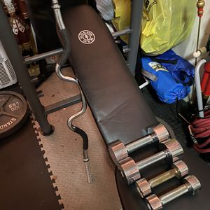 Golds gym bench rack wit bars and dumbbells for Sale in Damascus, OR