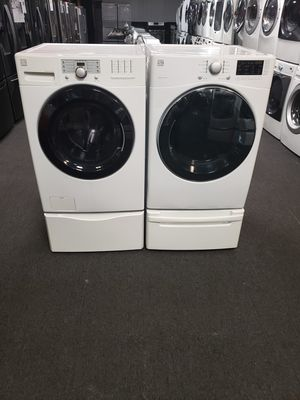 Kenmore front load washer and dryer set with pedestal nice and clean 90 day warranty for Sale in Baltimore, MD