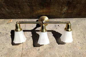Two brass wall mount 3 light fixtures. Barely if ever used or store display models. for Sale in Los Angeles, CA