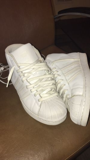 All white adidas, Timberland work boots, and custom made never worn levi shorts for Sale in Calumet City, IL
