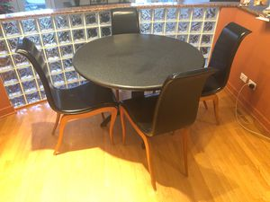 Polished stone round table with wrought iron base and set of 4 black leather dining chairs for Sale in Chicago, IL