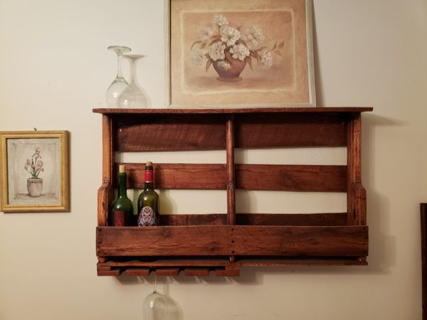 Wood shelving, wine rack (1), multi purpose racks (2), dog bed (1), wishing well (1) and table/desk (1). Items available start at $25 up to $70.