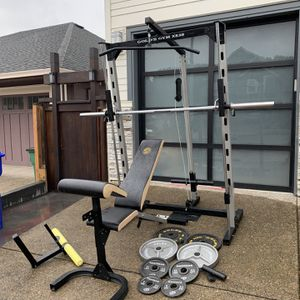 Complete Home Gym Setup: Smith Machine, Power Cage, Olympic Weight Set With Barbell, Adjustable Bench, Curl Pad, Leg Extension for Sale in Oregon City, OR