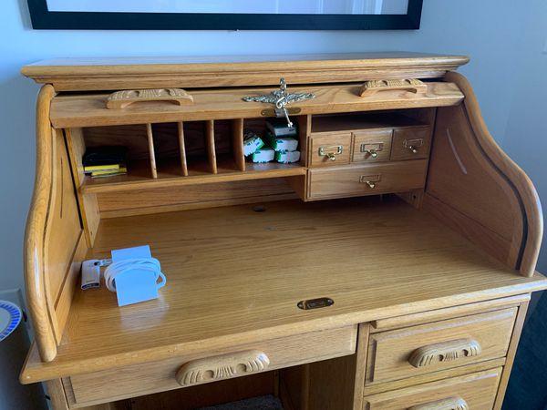 Small oak roll top desk.