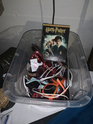 Box of glasses and Harry Potter movie for Sale in Ottumwa, IA