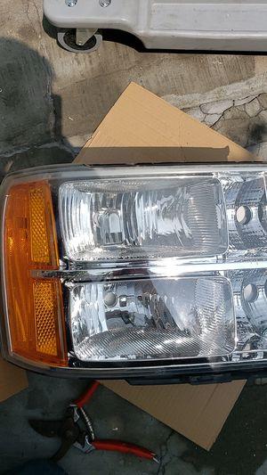 GMC Chevrolet Sierra Silverado Head lights 2007 to 2014 for Sale in Santa Ana, CA