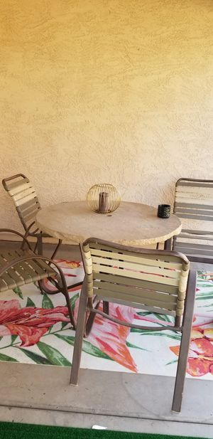 patio table with 4 chairs steel base stone look top with umbrella hole for Sale in Goodyear, AZ