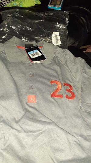 Brand new men's medium Jordan polo shirt Retro 12 wolf grey orange 30 obo for Sale in San Antonio, TX