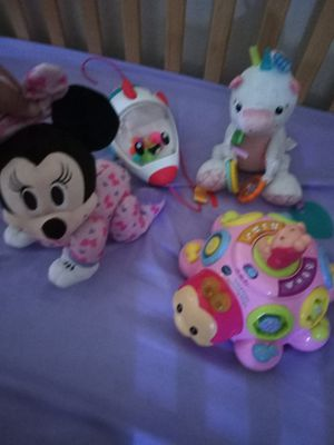 Disney's crawling Minnie mouse and other light up animated toy a unicorn rattle and a rocketship popper great for babies for Sale in Tampa, FL