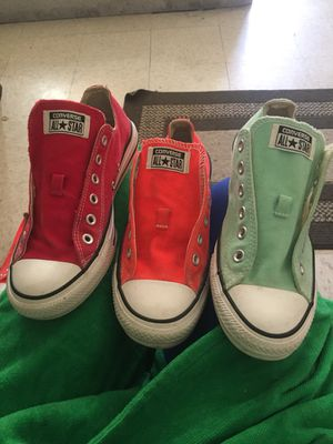 4pair of converse the orange pair & Pink pair Size 6mens & 9 in women & the other 2pair is a Size 7in men & 9 in women for Sale in Baltimore, MD