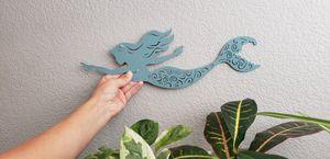 "Blue metal mermaid nautical decoration 15.25"" x 5.25"" Easy to hang on wall Die cut swimming metal mermaid with swirl pattern. for Sale in Ontario, CA"