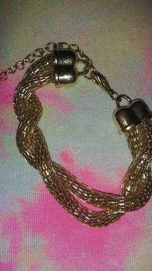 Gold tone twist rope chain bracelet for Sale in Lincoln Acres, CA