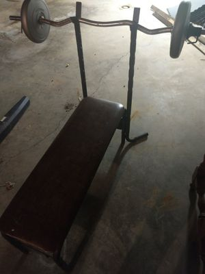 Basic weight bench with bar and basic weights for Sale in McConnelsville, OH