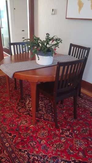 Solid wood dining table expanding for Sale in Seattle, WA