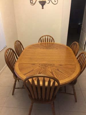 Solid oak dinette/kitchen table with 6 chairs and 1 removable leaf. for Sale in Alafaya, FL