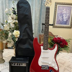 red huntington electric guitar with case cable strap and amp for Sale in Bell Gardens, CA