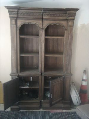 Oak cabinet good condition lighted glass shelves bottom storage shelf pair for Sale in Indio, CA