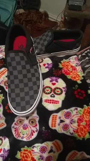 Black and grey universal size 7 vans for Sale in Seattle, WA