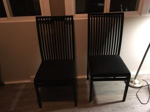 Black expandable oval dining room table and 4 chairs for Sale in Silver Spring, MD
