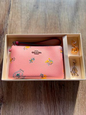Pink Dandelion Coach wristlet with 2 keychain pendants for Sale in Houston, TX