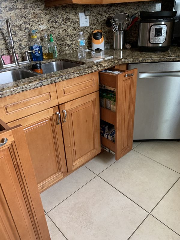 Bottom 2 cabinets on each side of stove have water damage ...