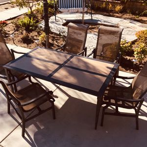 Outdoor dining table with 5 chairs. The rectangular tiles on the table are removable and the transportation is more convenient and lighter. for Sale in Garden Grove, CA