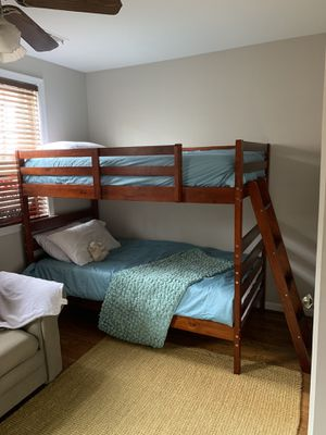 Bunk bed with bedding and mattresses for Sale in Alexandria, VA