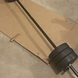 Beginner Barbell + Weight Plates Set (Up to 50lbs) New for Sale in Andover, MA