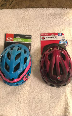 1: Bell Cadence Bicycle helmet ages 8-14 is the blue one. The other is a Breeze adult helmet ages 14 and up. for Sale in Franklin, TN