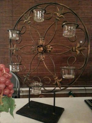 Very nice. Great gift idea..Large, heavy iron candle holders on metal pedestal 23 inches tall with 6 votives. for Sale in St. Louis, MO