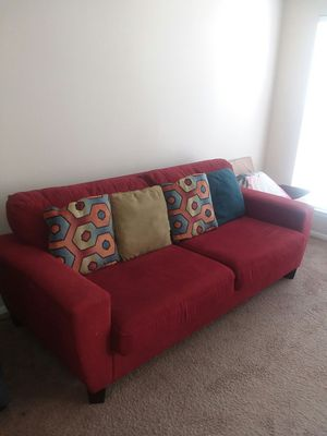 red comfy couch with pillows , Black Glass computer desk, And Wooden white Tiled Dinner Table for Sale in Dublin, OH