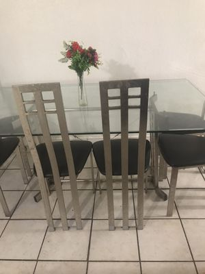 Big glass table,6 chairs flower pot not included for Sale in Garden Grove, CA