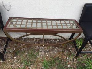 Cast metal glass top console table for Sale in Houston, TX