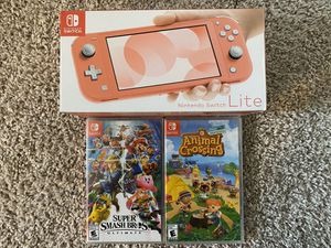 Nintendo Switch Lite Coral Animal Crossing and Super Smash Brothers for Sale in Alpharetta, GA