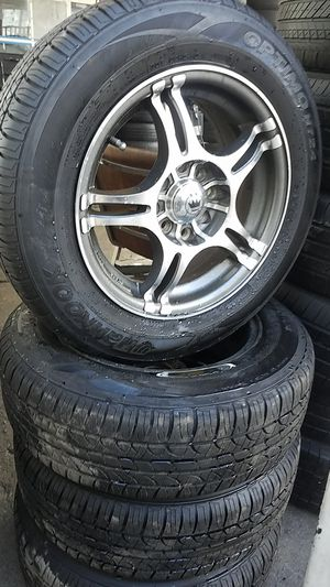"""14"""" 4 lug universal wheels with semi new tires and wheels for Sale in San Diego, CA"""