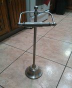 Brushed nickel toilet paper stand