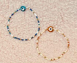 Fashion beaded stretchy bracelets 2 evil eye for Sale in Bellflower, CA