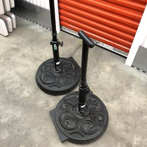 Black Metal Umbrella Bases w/Wheels for Sale in St. Louis, MO
