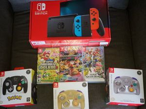 Brand new Nintendo Switch with 3 new games and 5 total wireless controllers for Sale in Arlington, VA