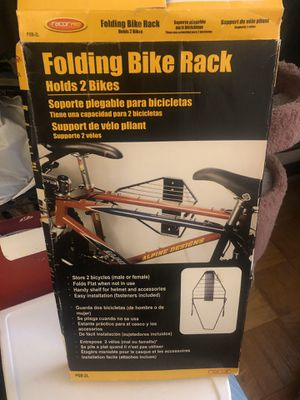 Folding bike rack for hanging bike on wall for Sale in Rockville, MD
