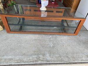 TV STAND - BEAUTIFUL WOOD and 3 SHELVES ( 48 inches back of glass & 52 inches in front of glass for Sale in Modesto, CA
