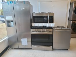 Frigidaire stainless steel side by side refrigerator ,gas stove,.dishwasher & microwave new with 6month's warranty for Sale in Washington, DC