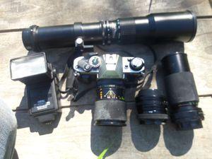 Canon ae-1 35mm camera/4 lenses/flash. for Sale in Sacramento, CA