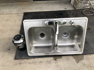 Stainless Steel Double Bowl Kitchen Sink with 3/4 HP Badger Garbage Disposal and Moen Faucet for Sale in Houston, PA