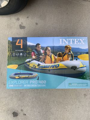 Intex Inflatable Explorer Pro 400 Four-Person Boat with Oars and Pump for Sale in San Antonio, TX