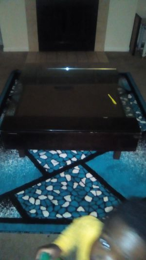Great Christmas tree ,clean carpet for living room and center table for living room for Sale in Loveland, OH