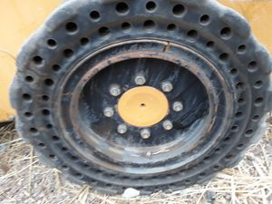 Tires and reems Solid for skid steer cat bobcat or john deere $ 480 obo for Sale in Brentwood, CA