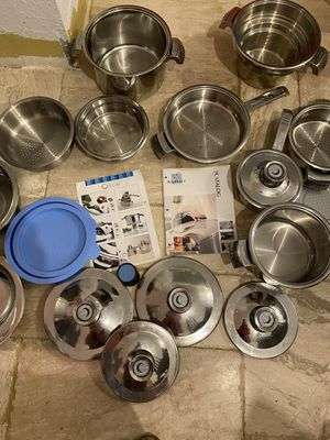 set of barley used pots pans strainers. knobs on lid tell you when there hot high end we bought an induction stove top and couldn't use them with it. for Sale in Palm Harbor, FL