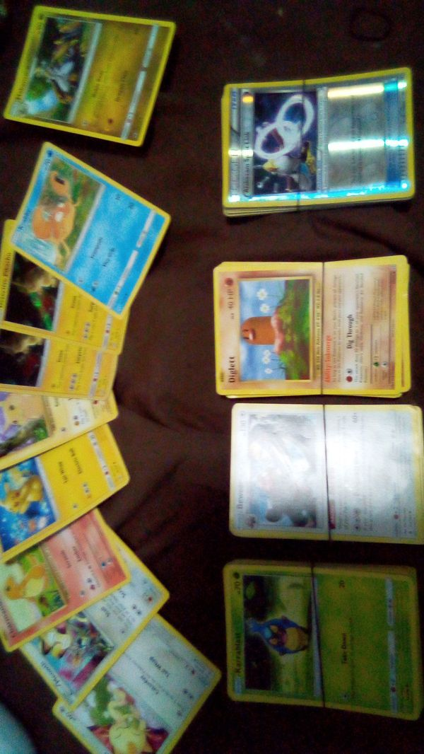 1995 2015 Pokemon collection 300 cards all aunthenic no games Google the cards on top almost$2500 cards