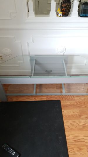 Glass tv stand for Sale in Roseville, MI